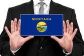 Zakenman houden een visitekaartje met vlag van montana — Stockfoto