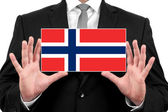 Businessman holding a business card with Norway Flag — Foto de Stock