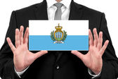 Businessman holding a business card with San Marino Flag — Foto de Stock