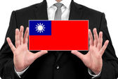 Businessman holding a business card with Taiwan Flag — Stock Photo