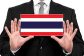 Businessman holding a business card with Thailand Flag — Foto de Stock