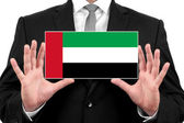 Businessman holding a business card with United Arab Emirates Flag — Foto de Stock