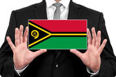 Businessman holding a business card with Vanuatu Flag — Stock Photo