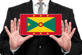 Businessman holding a business card with Grenada Flag — Stock Photo