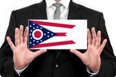 Businessman holding a business card with Ohio State Flag — Foto de Stock