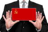 Businessman holding a business card with USSR Flag — Stock Photo