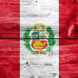 Peru Flag painted on old wood plank texture — Stock Photo