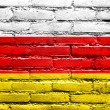 South Ossetia Flag painted on brick wall — Stock Photo