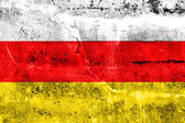 South Ossetia Flag painted on grunge wall — Stock Photo