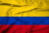 Macha flagą kolumbia — Zdjęcie stockowe