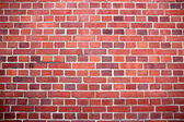 Red brick wall texture or background — Stok fotoğraf