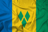 Waving Saint Vincent and The Grenadines Flag — Stockfoto