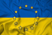 Waving Ukraine and EU Flag — Stockfoto
