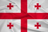 Развевающийся флаг Грузии — Стоковое фото