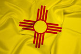 Agitant le drapeau de l'etat de new mexico — Photo
