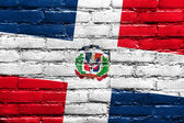 Dominican Republic Flag painted on brick wall — Stock Photo