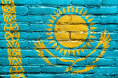 Kazakhstan Flag painted on brick wall — Stock Photo
