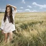 Portrait of pretty woman in the field — Stock Photo #9745489
