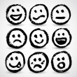 An icon set of grunge cartoon smiley faces — Stock Vector