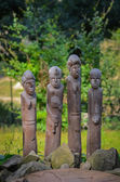 Wood carvings of primitive various African men — Stock Photo