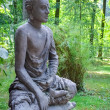 Zen stone buddha statue in nature — Stock Photo
