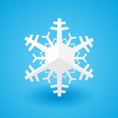 White paper christmas snowflake on a blue background with shadow — Stock Vector