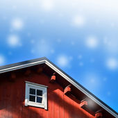 Typical norwegian red fishing hut with roof background — Stock Photo