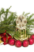 Christmas gift, golden clock and red New Year's balls — Stock Photo