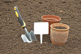 Scoop and pots for seedlings — Stock Photo