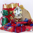 Stock Photo: Christmas gifts and clock