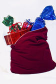Christmas gifts on the gifts sack — Stock Photo