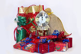Christmas gifts and clock — Stock Photo