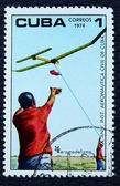 Postage stamp with the image of the model run air — Stock Photo