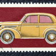 Stock Photo: Postage stamp with image of old Soviet car.