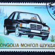 Stok fotoğraf: Postage stamp with image of car.