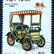 Postage stamp with the image of retro car — Stock Photo