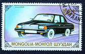 Postage stamp with the image of a car. — Stock Photo