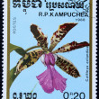 Stok fotoğraf: Postage stamp with image of orchid flower.