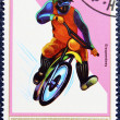 Postage stamp with the image of a motocross. — Zdjęcie stockowe