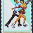 Postage stamp with the image of a figure skaters — Stock fotografie