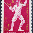 Stok fotoğraf: Postage stamp with image of swordsman