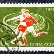 Photo: Postage stamp with image of football