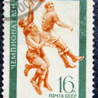 Стоковое фото: Postage stamp with image of football
