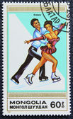 Postage stamp with the image of a figure skaters — Stock Photo