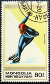 Postage stamp with the image of a skater — Stock Photo
