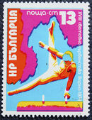 Postage stamp with the image of a gymnast — Stock Photo