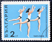 Postage stamp with the image of a gymnasts — Stock Photo