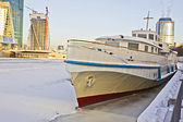 River ship frozen in the ice in winter — Stock Photo