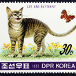 Postage stamp with the image of a cat and butterfly — Stok fotoğraf