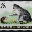 Postage stamp with the image the cat and rat — Stock Photo